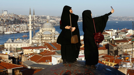 Women take selfie photographs with Hagia Sophia in the background in Istanbul, Turkey © Murad Sezer