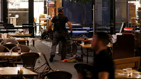 An Israeli policeman searches a restaurant following a shooting attack in the center of Tel Aviv June 8, 2016 © Baz Ratner