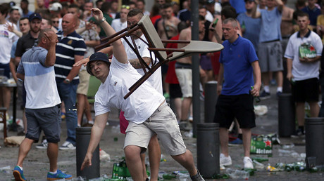 An England fan hurls a chair ahead of England's EURO 2016 match in Marseille, France, June 10, 2016. © Jean-Paul Pelissier