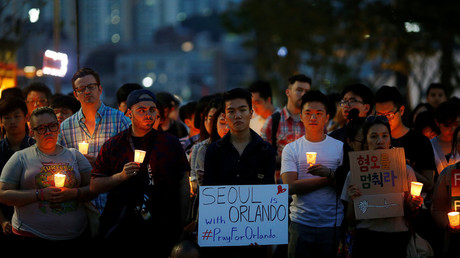 People attend a candlelight vigil in solidarity for the victims of the Orlando gay nightclub mass shooting, in Seoul, South Korea, June 13, 2016. © Kim Hong-Ji