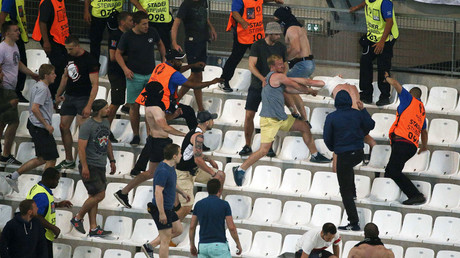 Soccer fans clash in the stadium after the match. © Robert Pratta