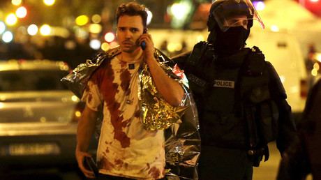 File photo: A French policeman assists a blood-covered victim near the Bataclan concert hall following attacks in Paris, France, November 14, 2015. © Philippe Wojazer
