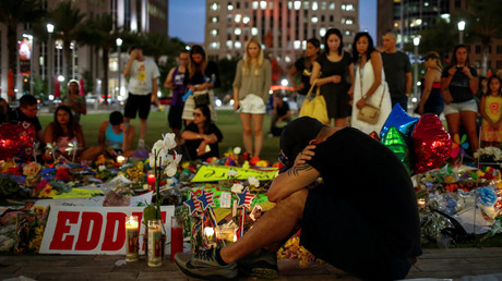 Local resident Jean Dasilva mourns for his deceased friend Javier Jorge-Reyes at a makeshift memorial in Downtown for victims of the gay night club shooting in Orlando, Florida, U.S., June 14, 2016. © Adrees Latif