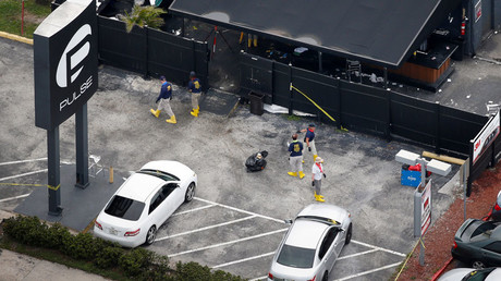 Federal Bureau of Investigation (FBI) officials collect evidence from the parking lot of the Pulse gay night club, the site of a mass shooting days earlier, in Orlando, Florida, U.S., June 15, 2016. © Adrees Latif