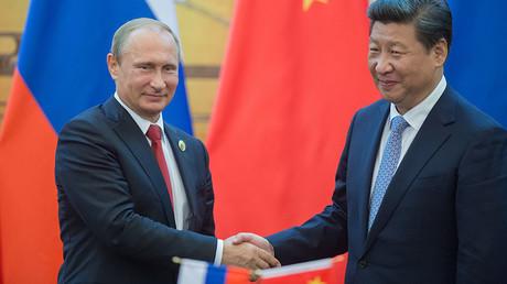 Russian President Vladimir Putin and Chinese President Xi Jinping. ©Sergey Guneev