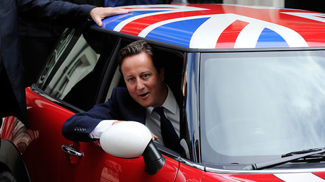 British Prime Minister David Cameron sits in the driving seat of a Mini Cooper outside Downing Street in London © Paul Hackett
