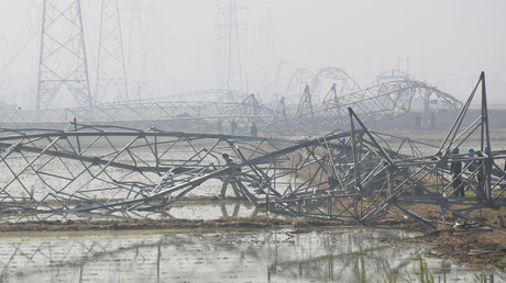 Rescue team working on damaged high-voltage towers after a tornado hit Funing on Thursday, in Yancheng, Jiangsu province, June 25, 2016. © Aly Song