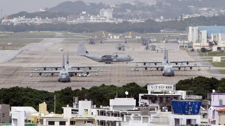 Hercules aircraft are parked on the tarmac at Marine Corps Air Station Futenma in Ginowan on Okinawa © Issei Kato