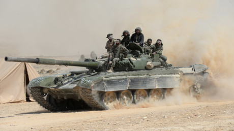 The Syrian Army supported by popular defense groups conducts an offensive on the city of al-Qaryatayn controlled by militants. © Mikhail Voskresenskiy
