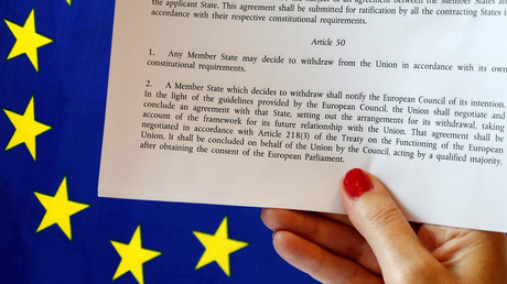 Article 50 of the EU's Lisbon Treaty that deals with the mechanism for departure is pictured near an EU flag following Britain's referendum results to leave the European Union, in this photo illustration taken in Brussels, Belgium, June 24, 2016. © Francois Lenoir