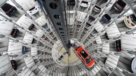 A VW Golf VII car (R) and a VW Passat are loaded in a delivery tower at the plant of German carmaker Volkswagen in Wolfsburg © Fabian Bimmer