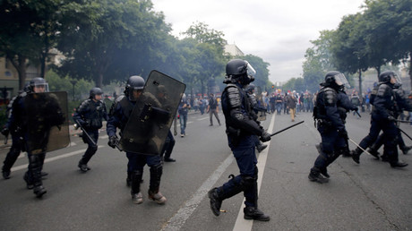 French riot police take position during clashes at a demonstration against plans to reform French labour laws in Paris, France, June 28, 2016. © Stephane Mahe