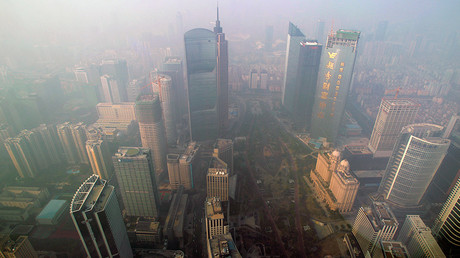 Buildings are seen through thick haze at the central business district in Guangzhou, Guangdong province © Alex Lee