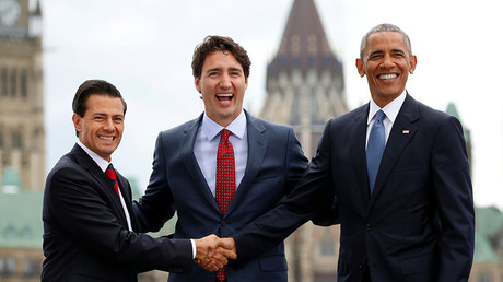 Mexican President Pena Nieto, Canadian PM Trudeau and U.S. President Obama pose for a group photo at the North American Leaders' Summit in Ottawa. © Kevin Lamarque