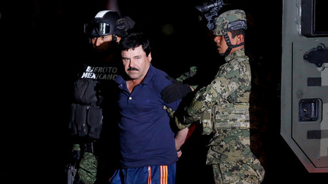 "FILE PHOTO: Joaquin ""El Chapo"" Guzman is escorted by soldiers during a presentation in Mexico City. © Tomas Bravo"