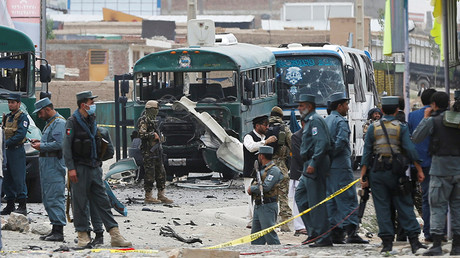 Afghan security forces inspect the damage caused by a suicide bombers at the site of the attackon the western outskirts of Kabul, Afghanistan June 30, 2016 © Omar Sobhani
