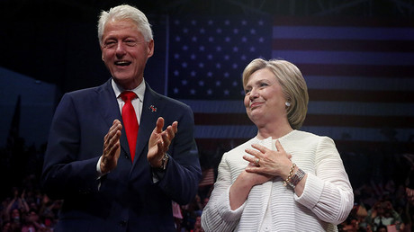 Democratic U.S. presidential candidate Hillary Clinton stands onstage with her husband former President Bill Clinton (L)  © Shannon Stapleton