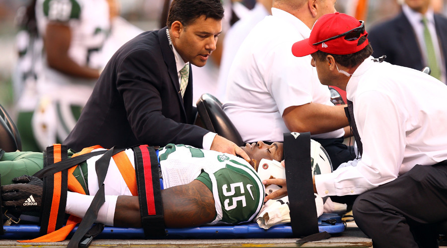 New York Jets linebacker Lorenzo Mauldin (55) is carted off the field on a stretcher with team doctors at the game against the Cleveland Browns. © Danny Wild