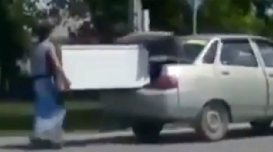 Niiice! Totally Borat moment in Kazakhstan as fiancée proves strength by carrying fridge (VIDEO)
