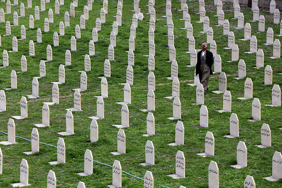 An Iraqi Kurd resident visits the cemetery for victims of the 1988 chemical attack in the Kurdish town of Halabja, near Sulaimaniya, 260 km (160 miles) northeast of Baghdad. ©Reuters