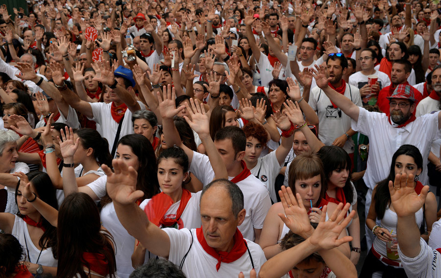 People take part in a protest against sexual violence against women during the San Fermin festival in Pamplona, northern Spain, July 7, 2016. © Susana Vera