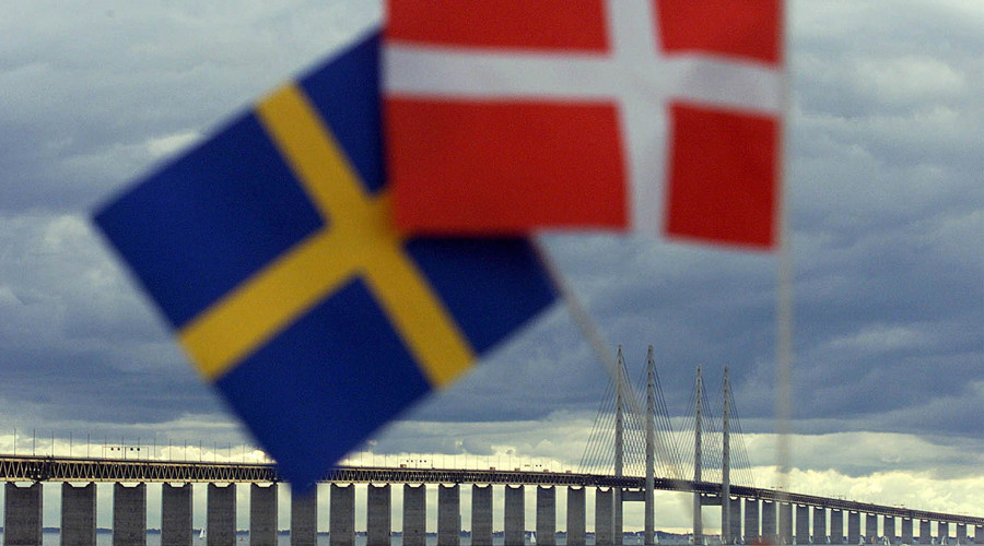 Swedish (L) and Danish flags © Reuters