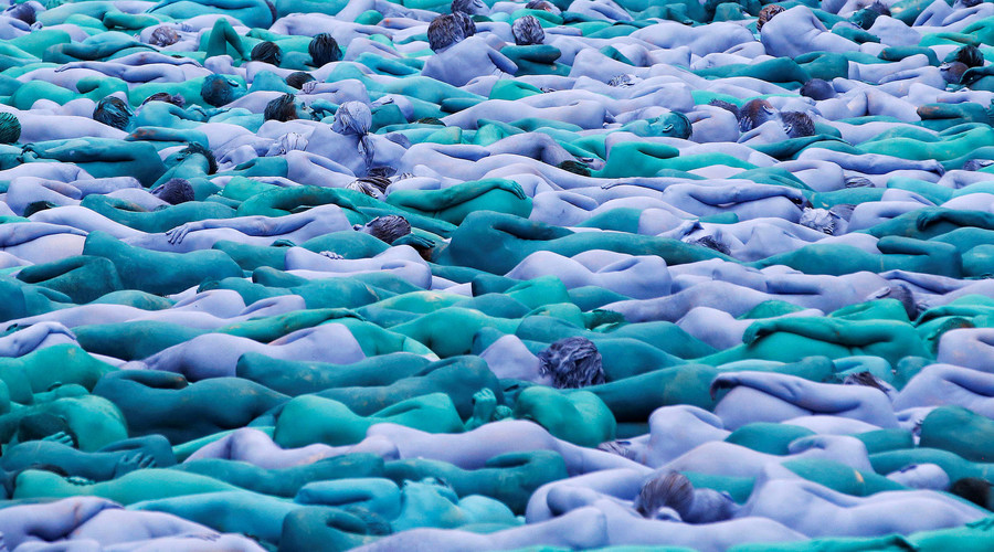 "Nude models pose for a photograph by U.S. artist Spencer Tunick, for a project titled ""Sea of Hull"" in Hull city centre, northern England, July 9, 2016. © Andrew Yates"