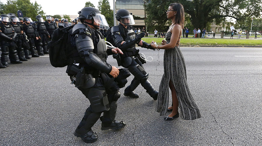 'Gorgeous, legendary': Black woman in flowing dress facing police in Baton Rouge wows social media