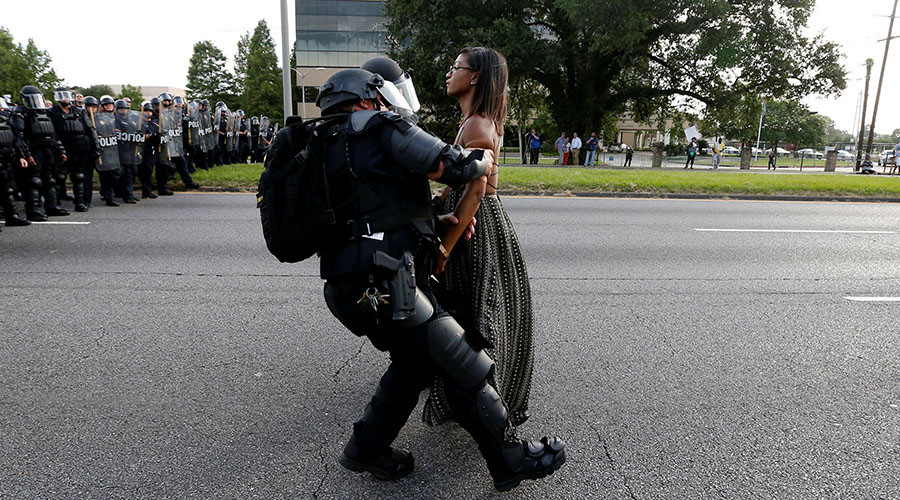Protestor Ieshia Evans is detained by law enforcement near the headquarters of the Baton Rouge Police Department in Baton Rouge, Louisiana, U.S. July 9, 2016. © Jonathan Bachman