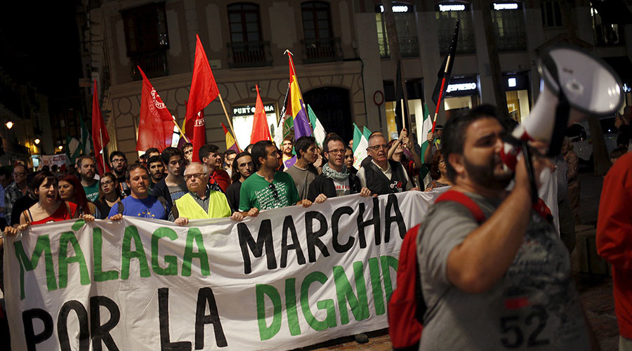 "People take part in a ""March for dignity"" to protest against austerity measures under the slogan ""Pan, techo, trabajo y dignidad"" (Bread, housing, job and dignity) in downtown Malaga, southern Spain. © Jon Nazca"