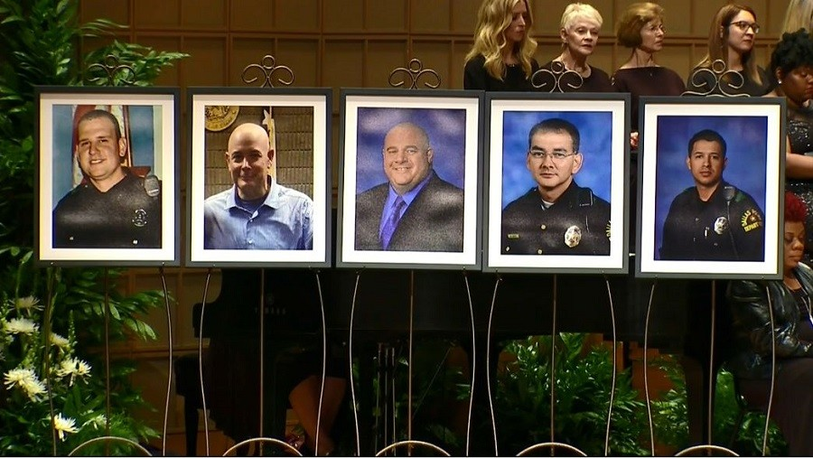 Photos of the five Dallas police officers at the interfaith memorial service
