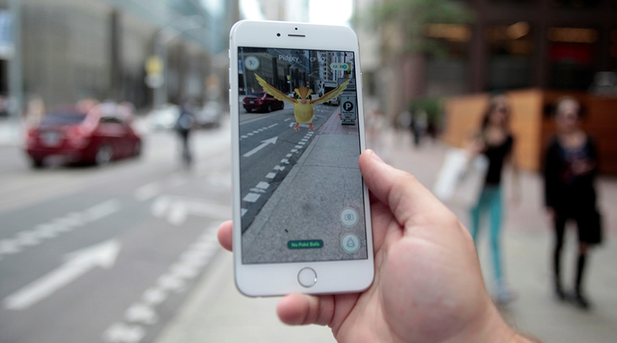 """A """"Pidgey"""" Pokemon is seen on the screen of the Pokemon Go mobile app, Nintendo's new scavenger hunt game which utilizes geo-positioning, in a photo illustration taken in downtown Toronto, Ontario, Canada July 11, 2016 © Chris Helgren"""