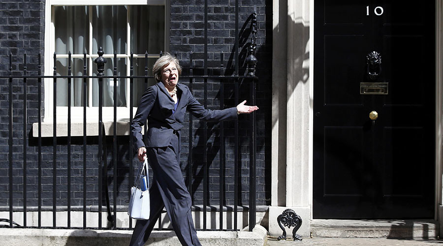 Over here, Theresa: UK's new PM gets muddled up leaving Downing St (VIDEO)