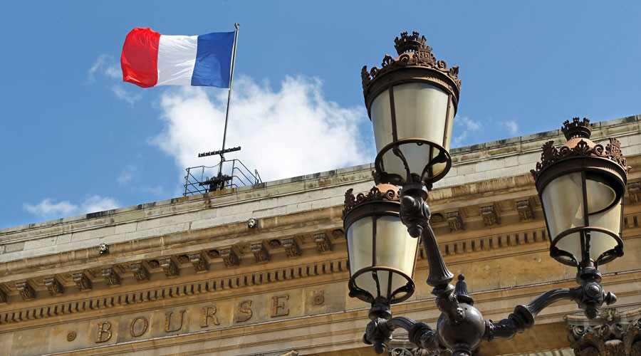 A flag flies from the roof of France's former Bourse or stock market building in Paris © Charles Platiau