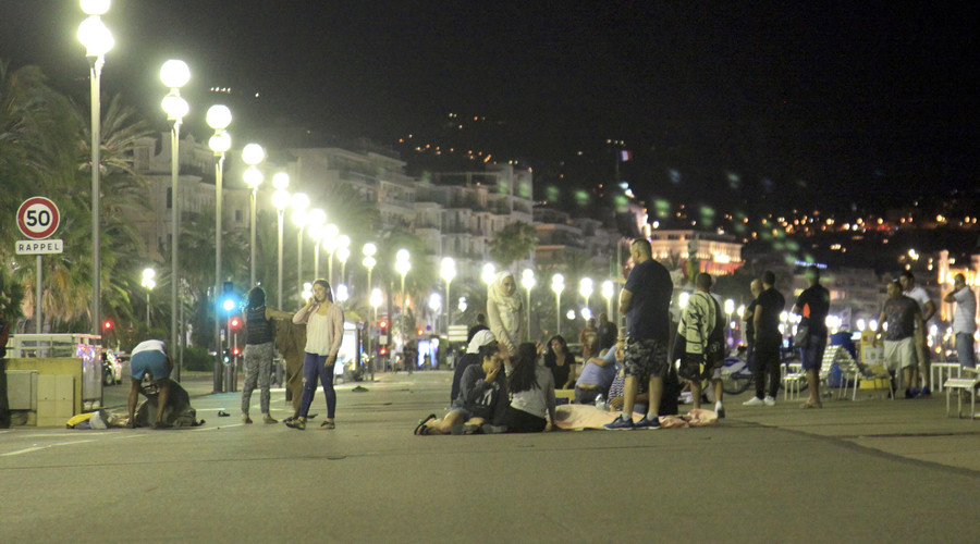 Blankets cover the dead and injured after a heavy truck ran into a crowd at high speed killing scores celebrating the July 14, 2016 Bastille Day national holiday on the Promenade des Anglais in Nice, France. © Tarubi Wahid Mosta