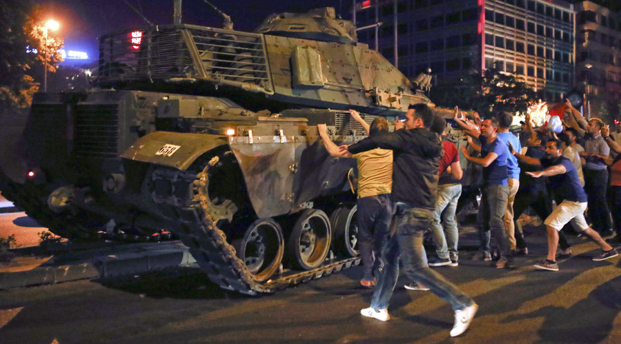 People react near a military vehicle during an attempted coup in Ankara, Turkey, July 16, 2016. © Tumay Berkin