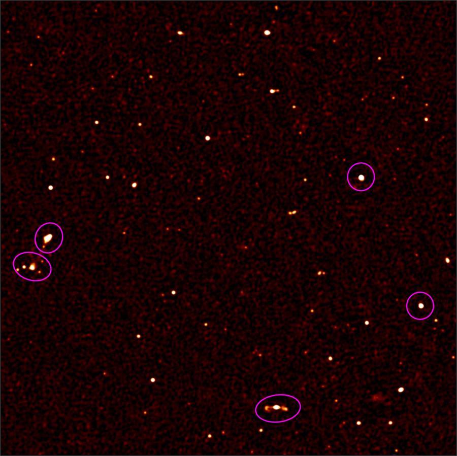View showing 10% of the full MeerKAT First Light radio image. More than 200 astronomical radio sources (white dots) are visible in this image, where prior to MeerKAT only five were known (indicated by violet circles). This image spans about the area of the Earth's moon. © ska.ac.za