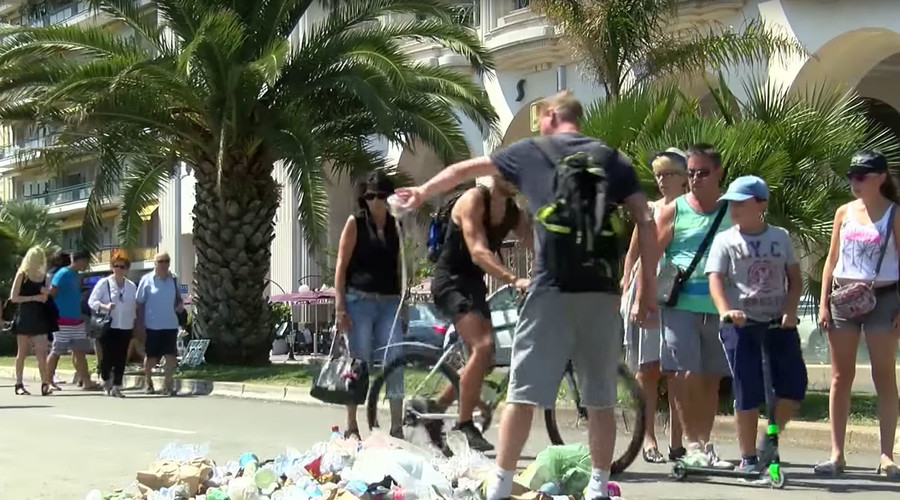 A heap of hate: People spit, throw garbage onto spot where Nice attacker was shot (VIDEOS, PHOTOS)