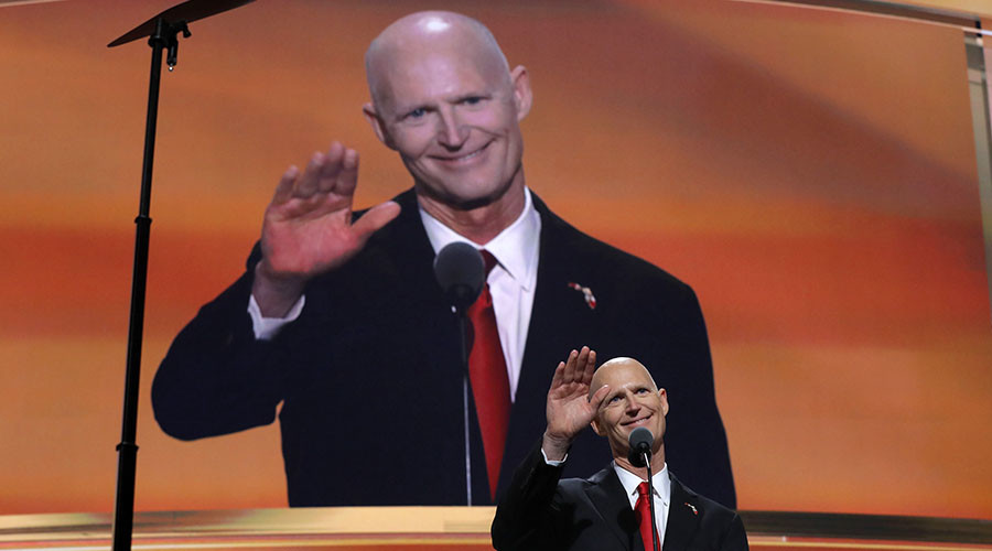 Florida Governor Rick Scott waves as he addresses the third session of the Republican National Convention in Cleveland, Ohio, U.S. July 20, 2016. © Brian Snyder
