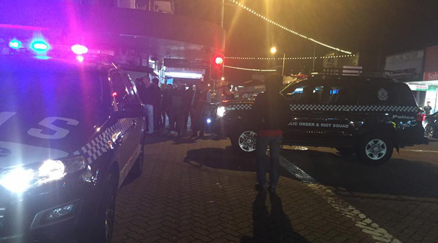 'Deliberate attack': Man sets himself alight, drives car into Sydney police station parking lot