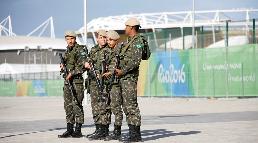 Brazilian Army Forces soldiers patrol outside the 2016 Rio Olympics Park in Rio de Janeiro, Brazil © Fabrizio Bensch