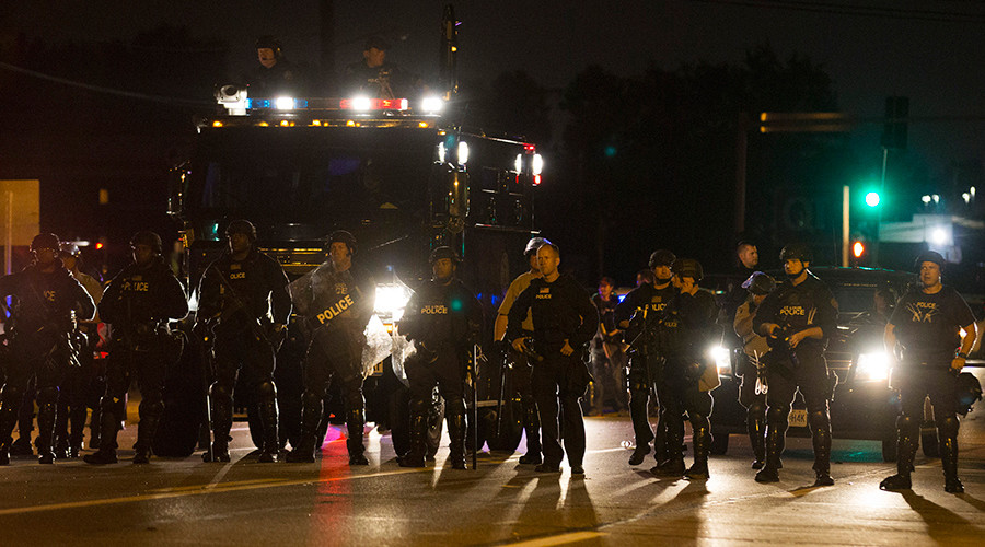 FILE PHOTO: Police officers patrol a street in Ferguson, Missouri August 11, 2014 © Mario Anzuoni