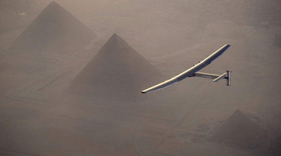 Solar Impulse 2, the solar powered plane, piloted by Swiss pioneer Andre Borschberg is seen during the flyover of the pyramids of Giza on July 13, 2016 prior to the landing in Cairo © Jean Revillard