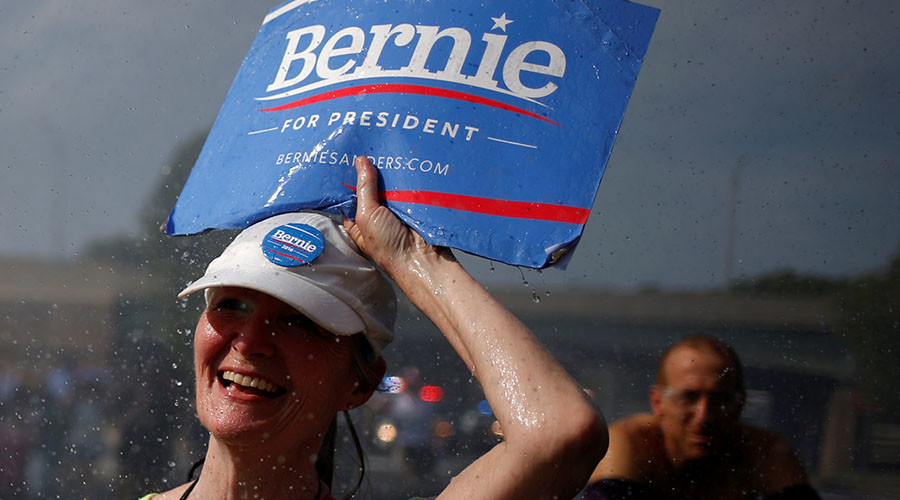 A supporter of U.S. Senator Bernie Sanders walks past a water hydrant during a protest march ahead of the 2016 Democratic National Convention in Philadelphia, Pennsylvania on July 24, 2016. © Adrees Latif