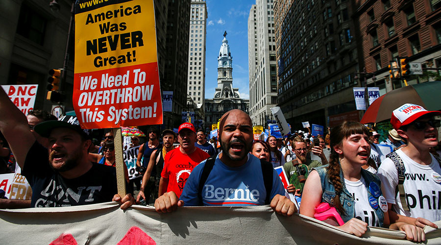 City Hall is seen in the background as supporters of U.S. Senator Bernie Sanders take part in a protest march ahead of the 2016 Democratic National Convention in Philadelphia, Pennsylvania, July 24, 2016. © Adrees Latif