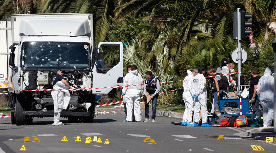 Investigators continue at the scene near the heavy truck that ran into a crowd at high speed killing scores who were celebrating the Bastille Day July 14 national holiday on the Promenade des Anglais in Nice, France, July 15, 2016. © Eric Gaillard