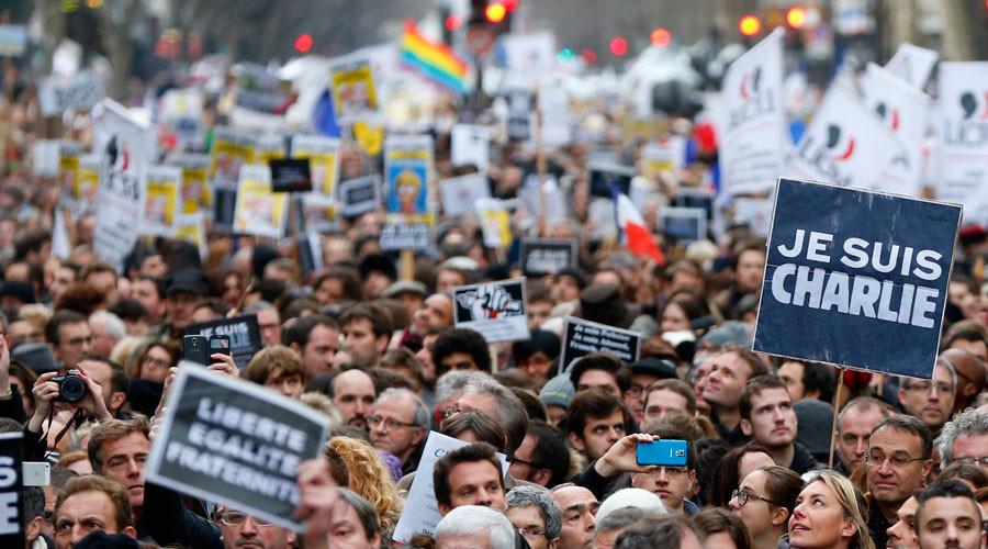 "People hold placards which read ""I am Charlie"" as they take part in a solidarity march (Marche Republicaine) in the streets of Paris January 11, 2015. © Yves Herman"