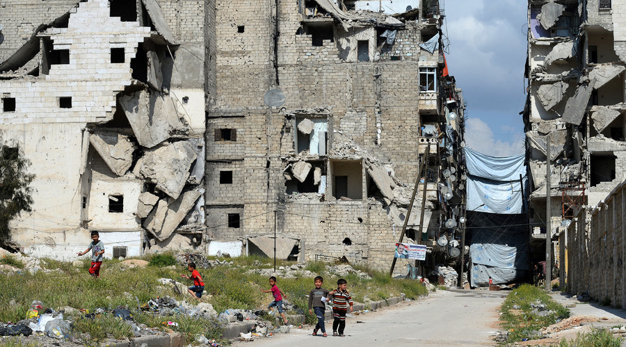 Children in the destroyed Salah ad-Din District in Aleppo. File photo.