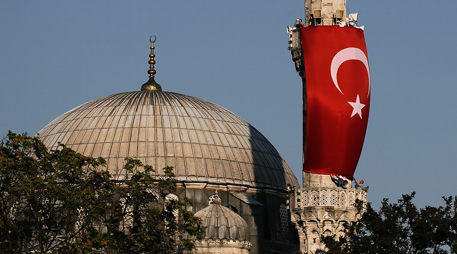 A Turkish flag is seen next to the dome of a mosque in Istanbul, Turkey © Alkis Konstantinidis