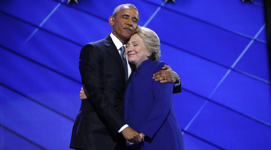 Democratic presidential nominee Hillary Clinton hugs U.S. President Barack Obama as she arrives onstage at the end of his speech on the third night of the 2016 Democratic National Convention in Philadelphia, Pennsylvania, U.S., July 27, 2016. © Jim Young